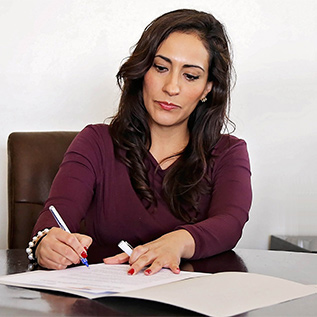 woman working in office on paperwork