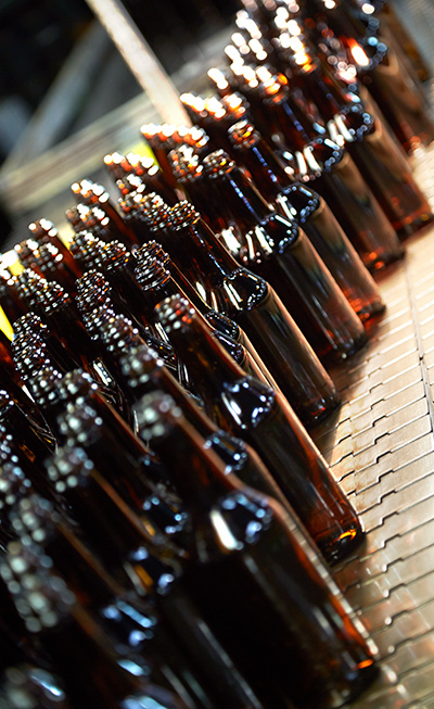 beer bottles post production Anchor Glass
